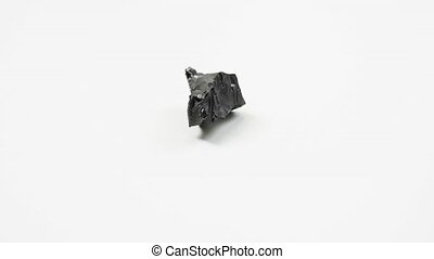 detail of anthracite coal over white background - detail of ...