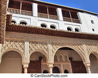Detail of arabic carvings in the Alhambra of Granada, Andalusia, Spain