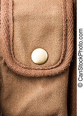 Detail of bag pocket - White button on brown pocket