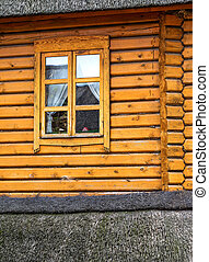 Detail of beams in the wall of the round log home built on old technology , wooden window as creative elements for natural background