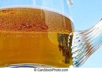 Detail of Beer Glass with Blue Background.