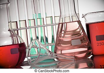 laboratory - detail of bottle and test tubes with colored...