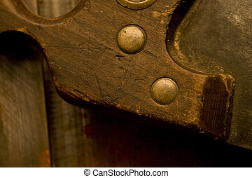 cross cut saw - Detail of brass rivets of an old beaver...