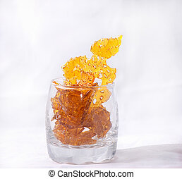 Detail of cannabis oil concentrate aka shatter isolated