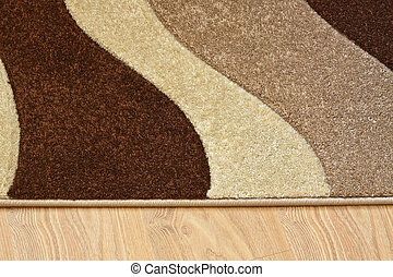 Detail of carpet in brown, beige and white colors on...