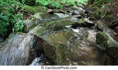detail of cascades on a stream - camera slide over detail of...