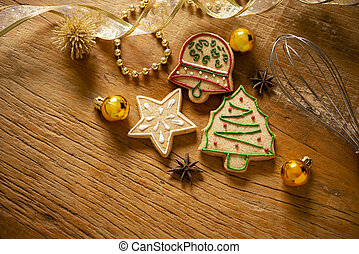 Detail of Christmas cookies on wooden table with ornaments.