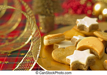 Detail of Christmas cookies with Xmas decoration in gold tone