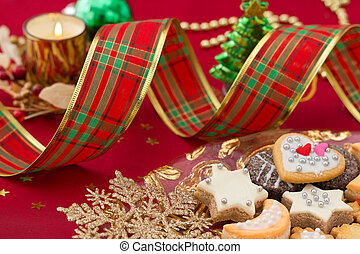 Detail of Christmas cookies with Xmas decoration in red and gold tone