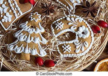 Detail of Christmas gingerbread cookies in a wicker basket