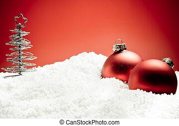 christmas tree near red decoration balls on snow