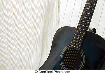 detail of classic guitar with shallow depth of field