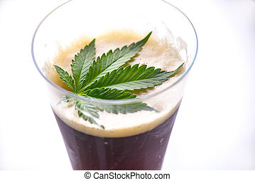 Detail of cold glass of beer with cannabis leaf isolated ...