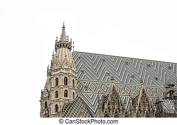 Detail of colorful rooftop and tower of St.Stephan Cathedral, Stephansdom in Vienna, Austria over white background. Famous gothic church, historical monument. Europe travel concept.