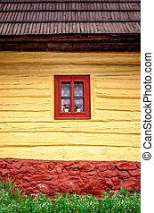 Detail of colorful window on old traditional wooden house