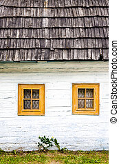 Detail of colorful windows on old traditional house