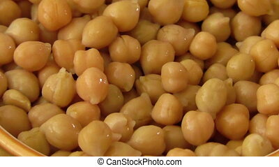 Detail of cooked chickpeas in ceramic bowl
