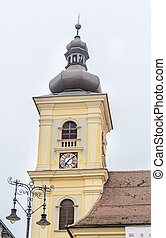 Detail of coupola situated near downtown of the city. Roof with old clock.