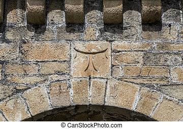 detail of cross tau Templar in Ponferrada Castle