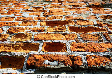 detail of damaged orange brick wall