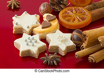 Detail of delicious Christmas cookies with spices on red