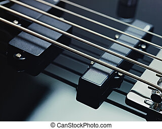 detail of electric bass, pickups and cords - closeup of...
