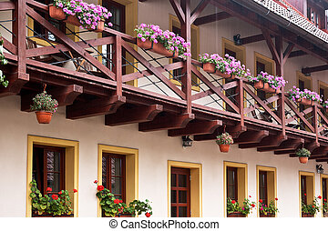 Detail of facade with courtyard balcony in the rain.