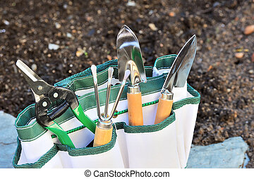 Detail of gardening tools in tool bag - outdoor