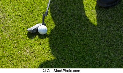 detail of Golf and a shadow of the athlete - Game of golf....