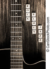 Detail of guitar and signs rock blues jazz in vintage style