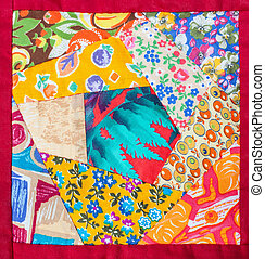 detail of hand made patchwork quilt in red framing