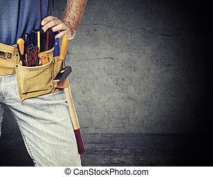 detail of handyman - closeup image on handyman tool belt