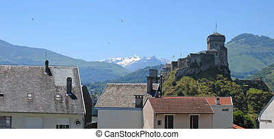 Detail of house and medieval castle from the old Lourdes...