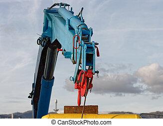 detail of hydraulic crane on a fishing vessel