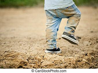 Detail of little boys legs in mud - Detail of little boys...