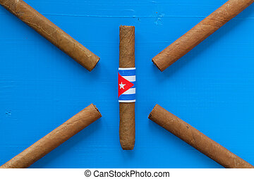 Detail of luxury Cuban cigars on the blue table