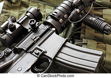 Detail of M4A1 (AR-15) carbine and tactical vest - Detail of...