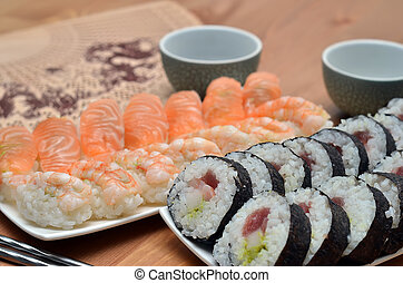 detail of maki sushi rolls and nigiri sushi with salmon and...