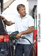 Detail Of Male Motorist Filling Car With Diesel At Petrol ...