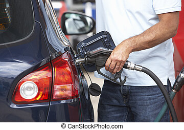 Detail Of Male Motorist Filling Car With Diesel At Petrol...