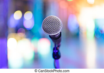Detail of microphone with blurred party lights - Detail of...