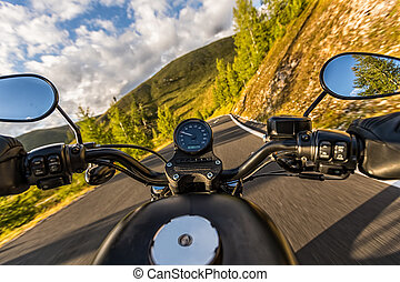 Detail of motorcycle handlebars. Outdoor photography, Alpine landscape.