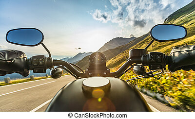 Detail of motorcycle handlebars. Outdoor photography, Alpine landscape