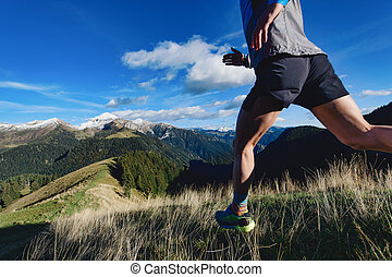 Detail of mountain runner legs during a downhill workout