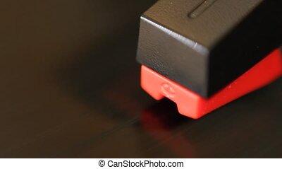 Detail of moving cartridge on spinning vinyl