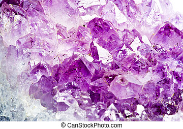 Amethyst - Detail of Natural Amethyst raw stone .