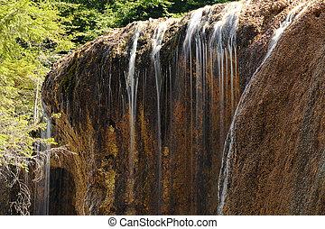 detail of natural waterfall, Urlatoarea cascade near Brasov,...