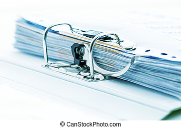 Detail of open folder filled with documents in cyan tone