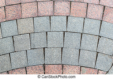 Detail of pavement, lined with ceramic granite square tiles