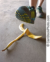 Person stepping on banana peel and slipping accident sidewalk floor